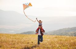 Happy family father and child daughter launch kite on meadow royalty free stock photos