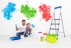 Happy family father and child daughter making repairs, paint wal Stock Photography