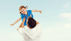 Happy family father and child daughter playing and having fun in Royalty Free Stock Photo