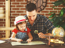 Happy family of father and child daughter prepare to  travel tri Stock Images