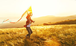Happy family father and child daughter run with  kite on meadow Royalty Free Stock Image