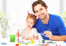 Happy family father and child  daughter together draw paints Stock Images
