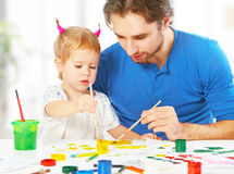 Happy family father and child daughter together draw paints. Happy family father and child baby daughter together draw paints stock photo