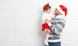 Happy family father and child with gift in Christmas Stock Photography