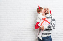 Happy family father and child with gift in Christmas kiss Stock Photography
