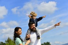 Happy family father and child on meadow with a kite in the summer on the nature. Enjoy. Happy family - child son playing stock image