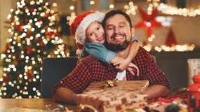 Happy family father and child pack Christmas gifts royalty free stock image