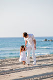 Happy family father and daughter on beach having fun Royalty Free Stock Image