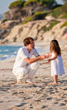 Happy family father and daughter on beach having fun Royalty Free Stock Images