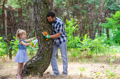 A happy family, father and daughter are playing in nature, a cop. Y of the free space. Background Father& x27;s Day Royalty Free Stock Photography