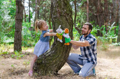 A happy family, father and daughter are playing in nature, a cop Stock Photos