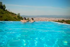 Happy family father and his little son at outdoors infinity swimming pool enjoying view of Tirana, Albania Stock Photo