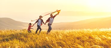 Free Happy Family Father, Mother And Child Daughter Launch A Kite On Stock Photos - 112054123