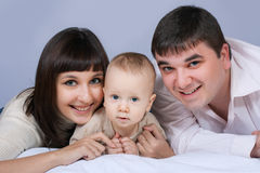 Happy family - father, mother and baby Royalty Free Stock Photos