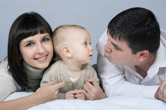 Happy family - father, mother and baby Stock Photos