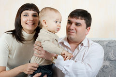 Happy family - father, mother and baby Stock Photo