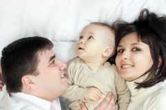 Happy family - father, mother and baby Stock Photography