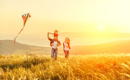 Happy family father of mother and child daughter launch a kite o Royalty Free Stock Photography