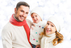 Happy family father mother and child daughter on winter walk Stock Images