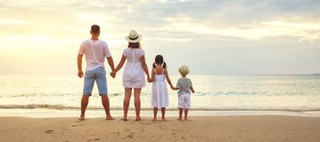 Happy family father, mother and children back  on beach at sea. Happy family father, mother and children back on the beach at sea royalty free stock photography