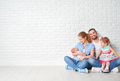 Happy family father mother and children at empty wall Stock Photo