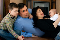 Happy family - father, mother, sister, brother Stock Photos