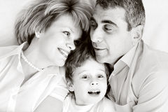 Happy family - father, mother and son. Happy family home: father, mother and - black and white photo stock photography