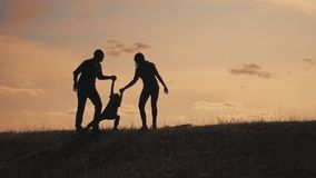 Happy family father, mother and son outdoors silhouette concept slow motion video. Dad man mom girl hold little boy son stock video