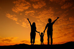 Happy family father mother and son playing outdoors at sunset si Stock Images