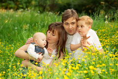 Happy family father, mother  and sons relaxing in the park Royalty Free Stock Photos
