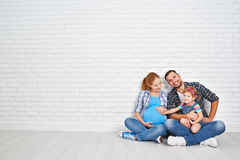Happy family father and pregnant mother and child daughter near Stock Images