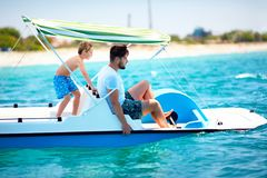 Happy family, father and son enjoy sea adventure on watercraft catamaran at summer vacation Stock Photography
