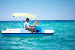 Happy family, father and son enjoy sea adventure on watercraft catamaran at summer vacation Stock Photo