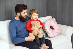Happy family. Father and son playing together Stock Photos