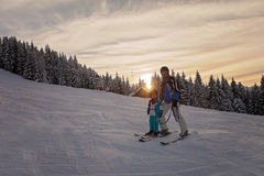 Happy family, father and son, in winter clothing at the ski reso Stock Images