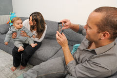 Happy Family-Father taking picture of mother and son. Father taking picture of mother and son at home Stock Photos
