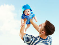 Happy family father throw up baby son on sky Royalty Free Stock Photography