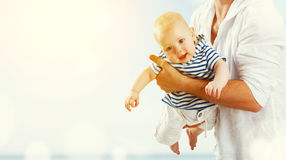 Happy family father throw up baby son on sky Royalty Free Stock Images