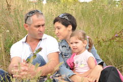 Happy family in the field Stock Image