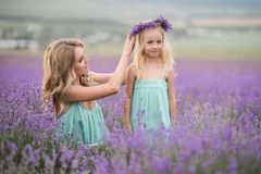 Happy family in a field of lavender. Mom and daughter in a field of lavender stock photography