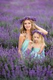 Happy family in a field of lavender. Mom and daughter in a field of lavender royalty free stock photo