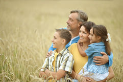 Happy family at field Royalty Free Stock Images