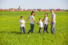 Happy family in a field Royalty Free Stock Photo
