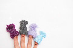 Happy family fingers. In warm knitted hats with bubonic rejoices first winter snow Royalty Free Stock Photos
