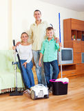 Happy family  finished cleaning in home. Portrait of happy family of three finished cleaning in home Stock Photos