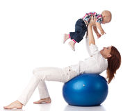 Happy family with  fitness ball. Royalty Free Stock Photos