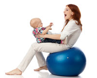 Happy family with  fitness ball. Stock Image