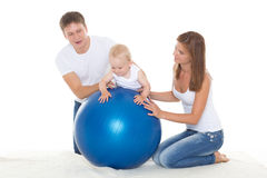 Happy family with fitness ball. Royalty Free Stock Images