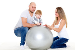Happy family with fitness ball. Stock Images