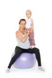Happy family with fitness ball. Royalty Free Stock Photo